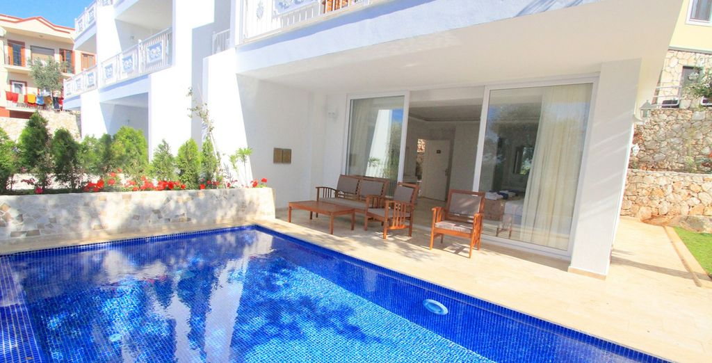 Complete with a private pool with partial sea views