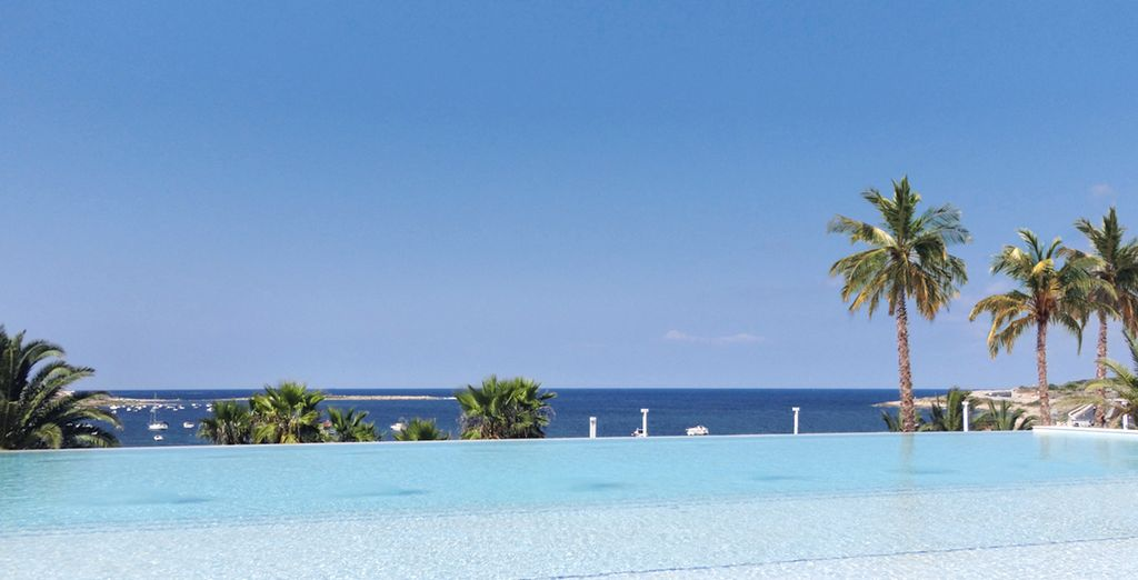 Then lounge by pool, admiring panoramic sea views...