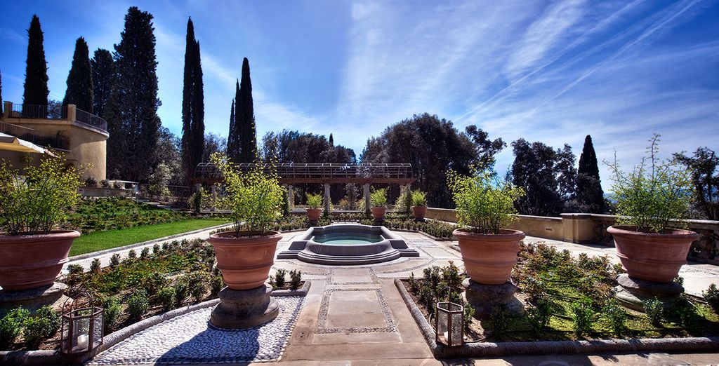 Its extensive grounds include a greenhouse area, private park, and landscaped gardens