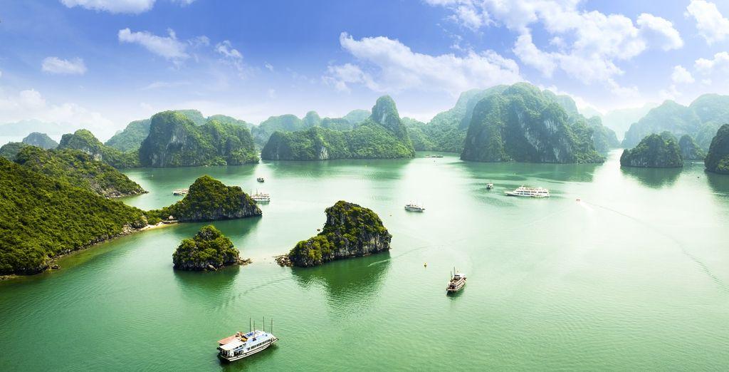 Next you'll cruise around iconic Ha Long Bay